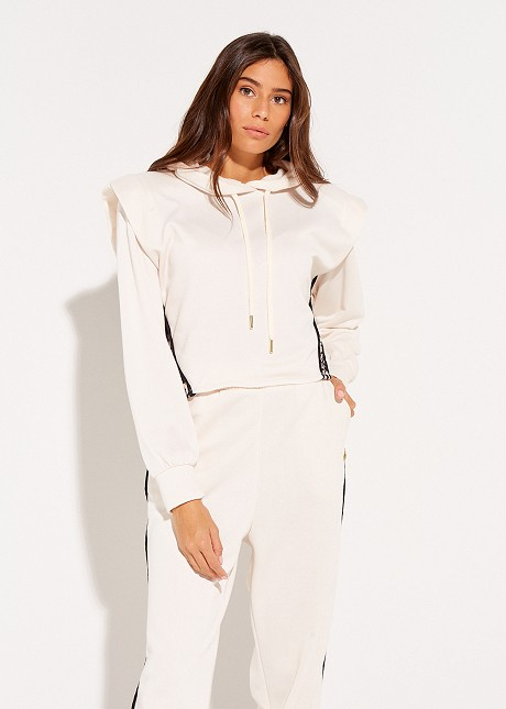 Blouse with hood and shoulder pads